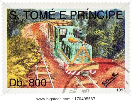 MOSCOW RUSSIA - February 10 2017: A stamp printed in Sao Tome and Principe shows picture of raylway in the forest with small diesel locomotive series