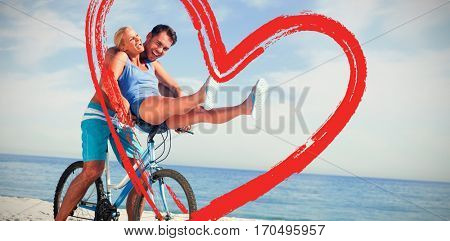 Happy man giving girlfriend a lift on his crossbar against print