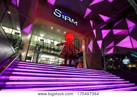 Bangkok Thailand - June 05 2012: Entrance of Siam Center one of the shopping mall in Siam Square famous landmark in Center of Bangkok area with Red Giant Girl Doll