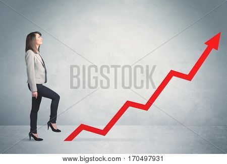 Business person climbing on red graph arrow