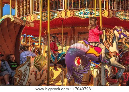 San Francisco, California, United States - August 14, 2016: smiling children funny of popular Carousel at Fisherman's Wharf shopping center of Pier 39. Leisure, recreation and holidays concept.