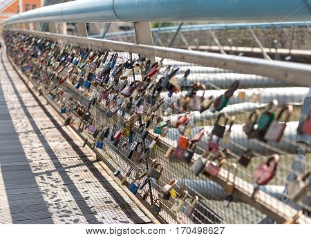 Heavy locks on the bridge, symbolising happy long relationship in Krakow, Poland