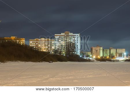 multi-storey building on the waterfront at night vologda russia