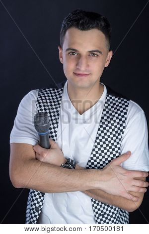 Young Male Black-haired Pop Singer Performs Singing To Microphone