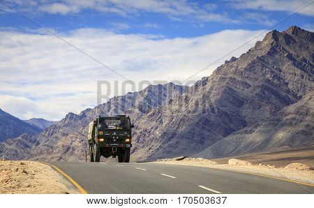 Kashmir, India - July 10, 2016: A military truck on the road. Ladakh region of Kashmir has significant Indian military presence