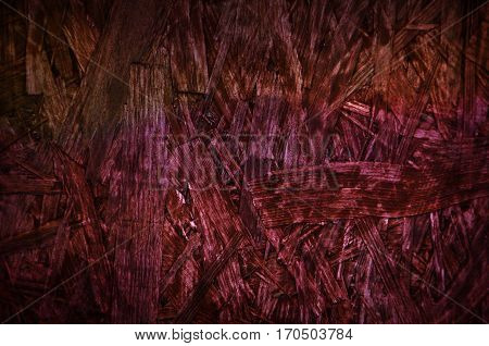 Burgundy red chipboard particle board desk surface wooden background texture
