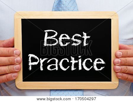 Best Practice - Businessman holding chalkboard with text