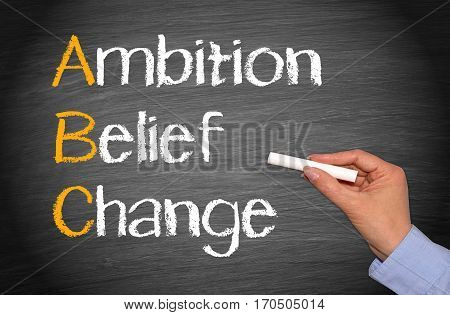 Ambition - Belief - Change - female hand writing text