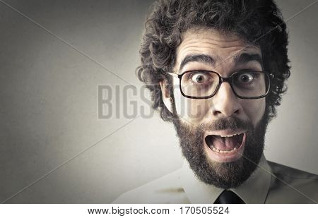 Businessman with beard feeling surprised