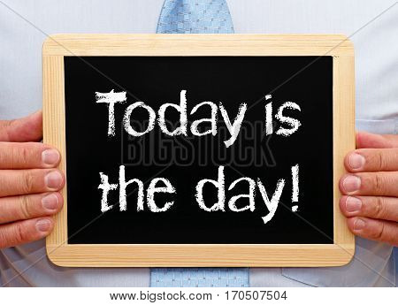 Today is the day - Businessman with chalkboard