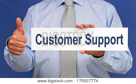 Customer Support - Businessman with sign and thumb up
