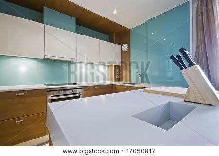 modern kitchen with white worktop wodd and glass elements
