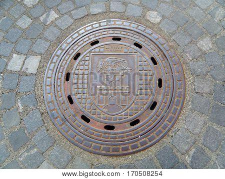 Manhole Cover found on the cobblestone path in Ljubljana of Slovenia