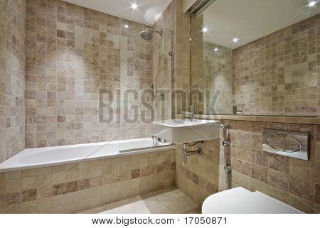 modern bathroom with natural floor to ceiling stone tiles