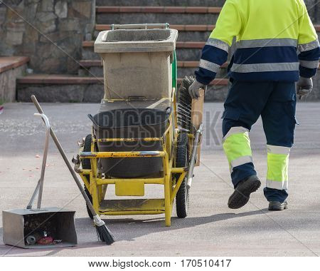 image of garbage trolley of street sweeper poster