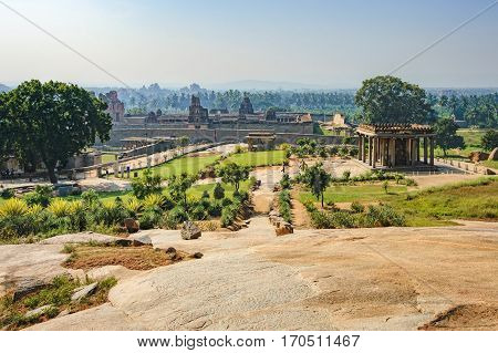 View of Prasanna Narasimha Temple and Sasivekalu Ganesha from the hill. Ancient ruins of Vijayanagara Empire in Hampi, Karnataka, India.