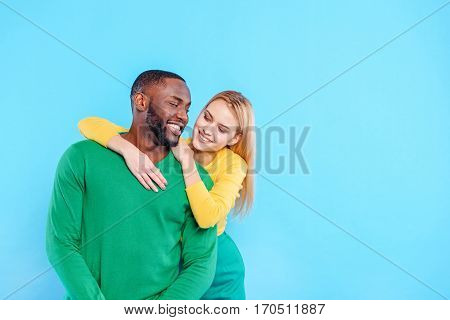You are love of my love. Colorful couple is embracing and looking at each other with gentleness. They are standing and smiling. Isolated and copy space in right side