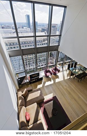 duplex apartment with two floors large windows and city views