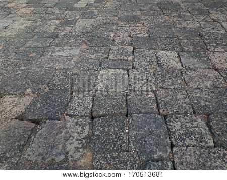 Dark and light gray tone of ancient rough stone floor of Prasat Hin Muang Tam Temple Complex in Thailand