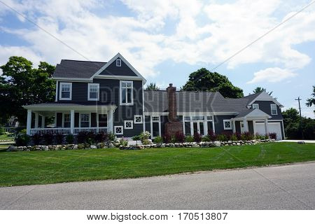 HARBOR SPRINGS, MICHIGAN / UNITED STATES - AUGUST 4, 2016: A large home at the corner of Fourth and Harrison Streets in Harbor Springs.