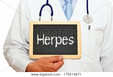 Herpes - Doctor holding chalkboard with text on white background