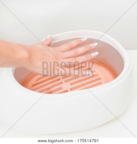 Paraffin wax bath, close up, white background
