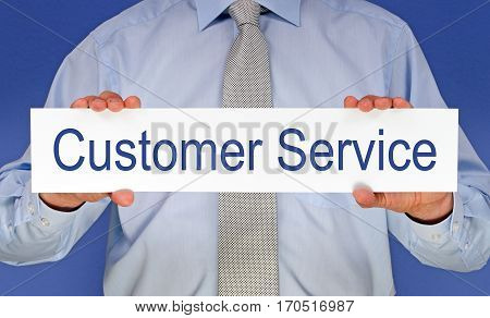 Customer Service - Businessman holding sign with text