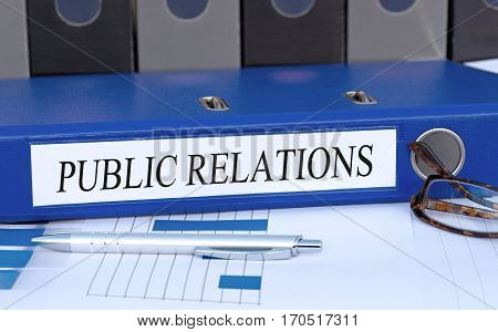 Public Relations - blue binder on desk in the office