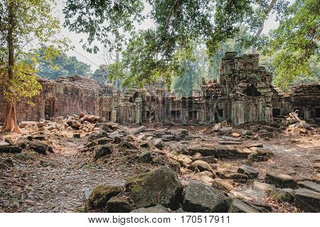 Od ruins of Preah Khan Temple in Siem Reap, Cambodia. Preah Khan has been left largely unrestored with trees and other vegetation growing among the ruins.