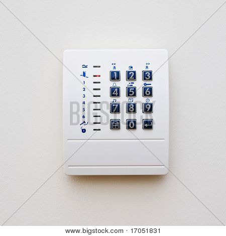 dial of a domestic property alarm with function buttons