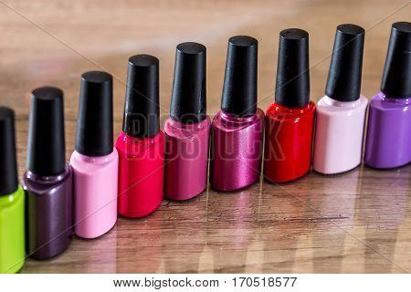 many Nail polish colorful on desk. close up