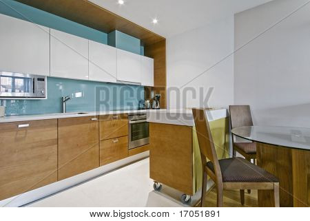 contemporary open plan kitchen with separate work zones and dining table