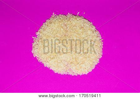 Basmati white uncooked rice on hot violet background. minimalism background isolated