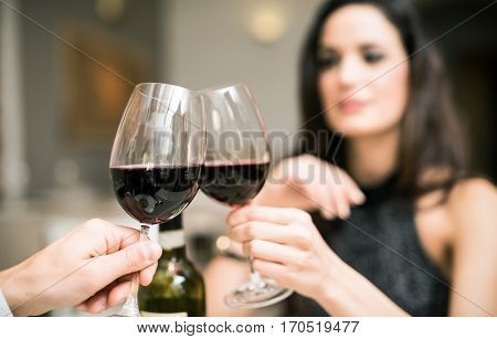 Woman toasting her wine glass