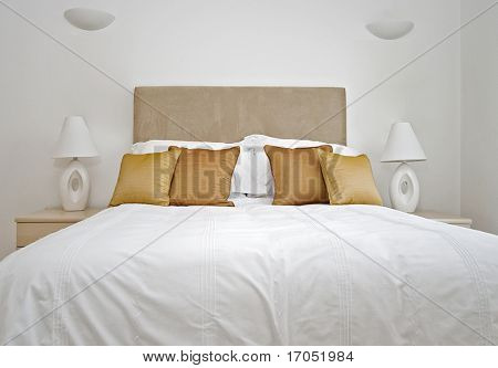 double bed with bedside tables and reading lamp