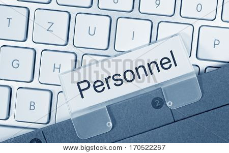 Personnel - folder with text on computer keyboard