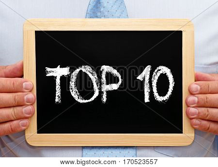 Top 10 - Businessman holding chalkboard with text