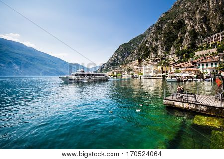 Ferry leaves from Limone del garda lake garda Italy.