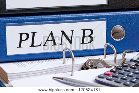 Plan B - blue binder with text on desk in the office