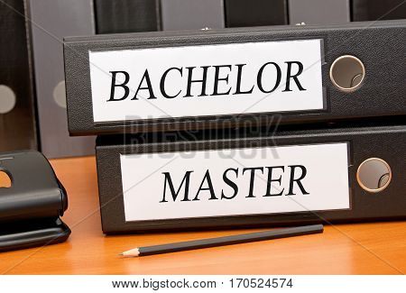 Bachelor and Master - two binders on desk in the office