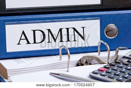 Admin - blue Administration binder on desk in the office