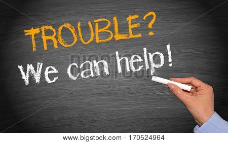 Trouble? We can help! - female hand writing text on blackboard background