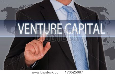 Venture Capital - Businessman with touchscreen and text