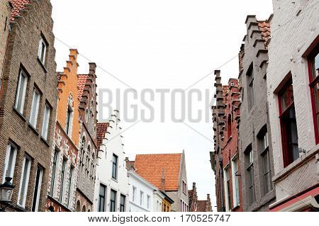 Tipycal north european pitched roof houses view from the road old architecture sample