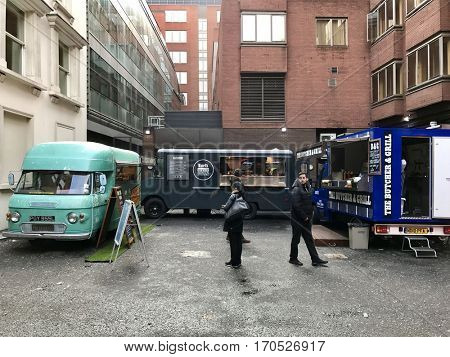 LONDON - FEBRUARY 3, 2017: Food trucks selling gourmet lunch sandwiches and snacks to hungry office workers in Mayfair, London, UK.