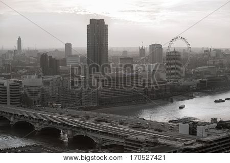 London, UK - December 19, 2016: London at sunset with. View at the Westminster aria, London eye, River Thames, embankment and London bridge