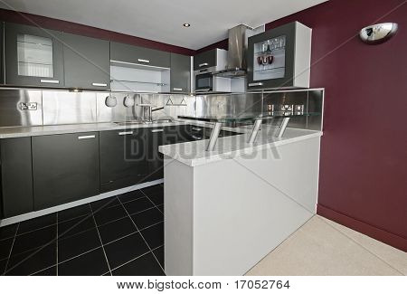 modern kitchen detail with stainless steel elements and breakfast bar