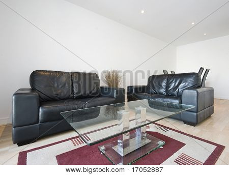 modern living room with chunky black leather sofa