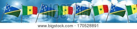 Solomon islands flag with Senegal flag, 3D rendering