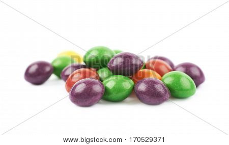 Pile of colorful chewing candies isolated over the white background